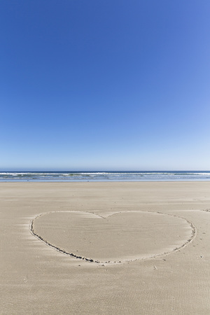 Canada,British Columbia,Vancouver Island,Pacific Rim National Park Reserve of Canada,Long Beach,heart in the sand LANG_EVOIMAGES