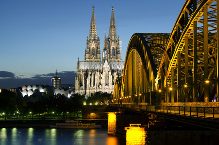 Germany,Cologne,View of Cologne Cathedral and Hohenzollern Bridge with River Rhine