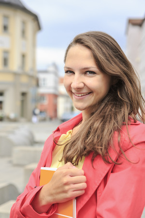 Germany,Thurinigia,Sonneberg,Smiling teenage girl in pink coat outdoors LANG_EVOIMAGES