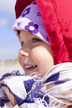 Denmark,Ringkoebing,smiling little girl LANG_EVOIMAGES