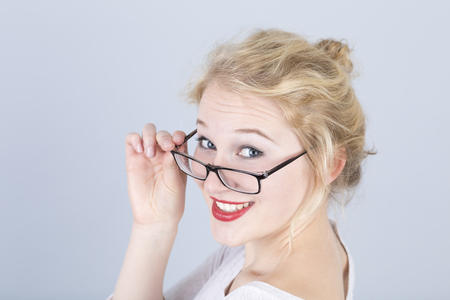 Portrait of young woman with spectacles LANG_EVOIMAGES