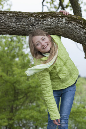 Germany,Bavaria,girl climbing on an oak