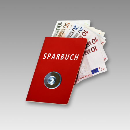 Bank book with vault button and Euro notes,Composing