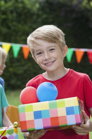 Boy holding birthday present