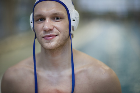Smiling water polo player outside pool,portrait