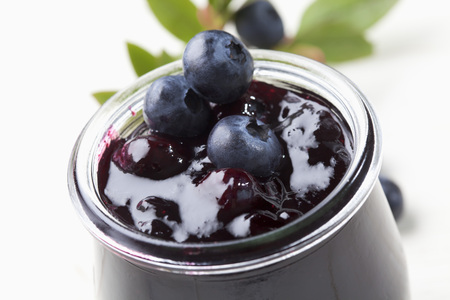 Glass of blueberry marmelade and some berries,studio shot