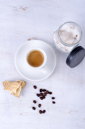 Espresso with coffee beans and sugar
