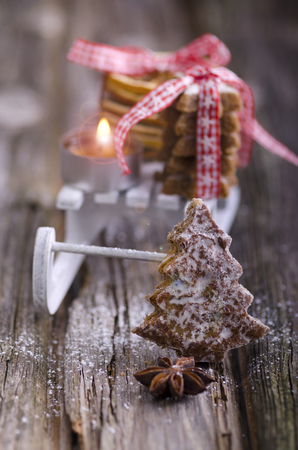 Gingerbread with miniature sledge,cinnamon stars and candle
