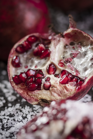 Opened pomegranate with corsican sea-salt,studio shot