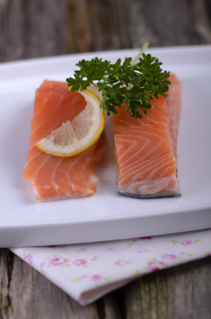 Raw salmon on a plate LANG_EVOIMAGES