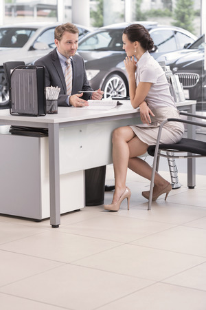 At the car dealer,Salesman talking to client