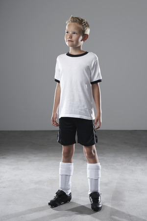 Boy in soccer jersey LANG_EVOIMAGES