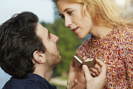 Germany,Dusseldorf,Young man proposing to woman