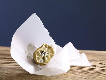 Rotting lemon in paper
