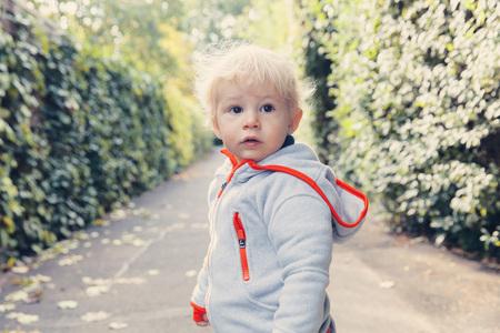 Germany,Bonn,Baby boy standing in street