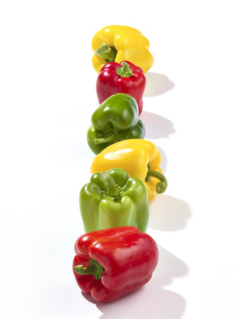Row of red,green and yellow bell peppers LANG_EVOIMAGES