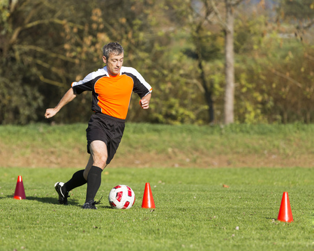 Soccer player passing a slalom course