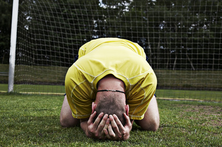 Frustrated soccer player on field