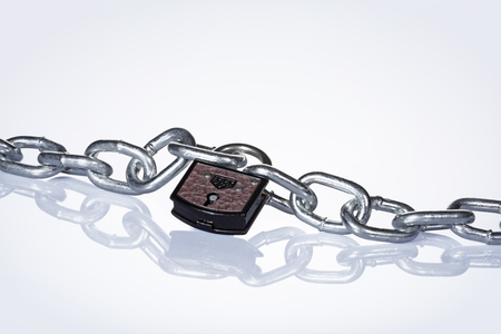 Chain with padlock against white background