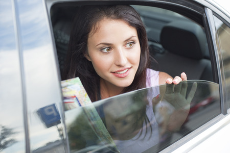 Young woman looking out of car window LANG_EVOIMAGES