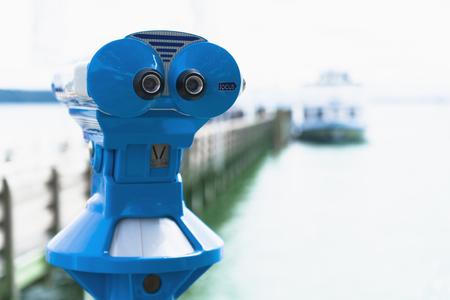 Germany,Bavaria,Lake Starnberg,binocular at jetty LANG_EVOIMAGES