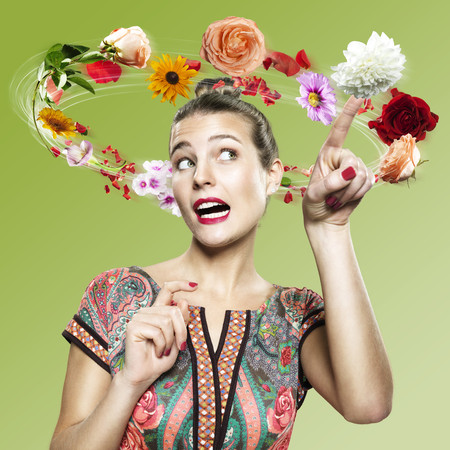 Young woman with flying flowers around her head,Composite