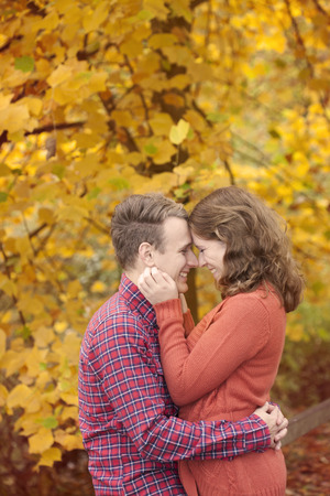 Happy young couple enjoying autumn