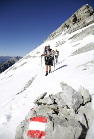 Austria,Tyrol,Karwendel mountains,Mountaineers crossing snowfield