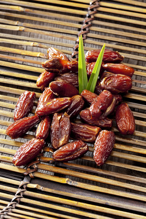 Tunisian dates on bamboo tray LANG_EVOIMAGES