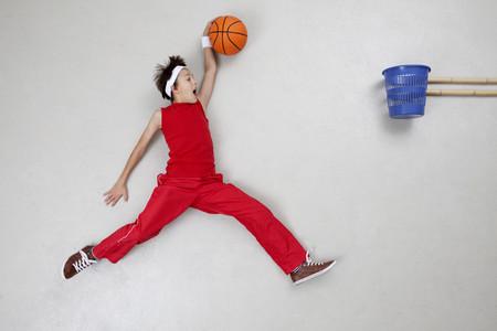 Boy playing basket ball LANG_EVOIMAGES