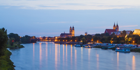 Germany,Saxony-Anhalt,Magdeburg,Cityscape with River Elbe at dusk