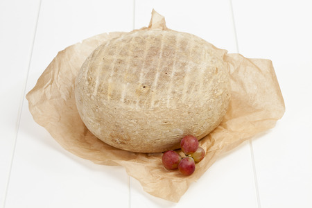 French Bethmale cheese and grapes on greaseproof paper LANG_EVOIMAGES