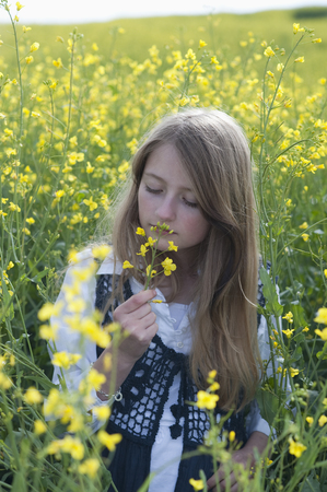Germany,Bavaria,Starnberg,girl in a rape field