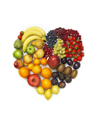Variety of vegetables and fruits on white background,heart shape