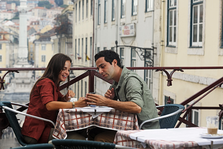 Portugal,Lisboa,Carmo,Largo du Duque,young couple sitting at street cafe