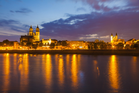 Germany,Saxony-Anhalt,Magdeburg,Cityscape with River Elbe,monastery and cathedral at dusk