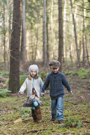 Germany,North Rhine-Westphalia,Moenchengladbach,Scene from fairy tale Hansel and Gretel,brother and sister in the woods LANG_EVOIMAGES