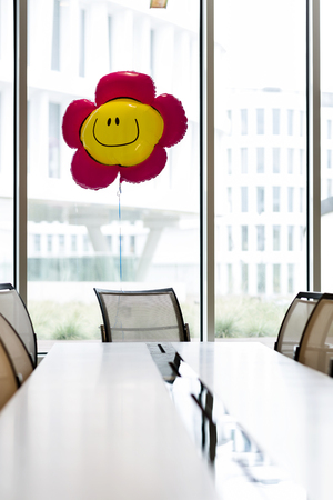 Poland,Warsaw,conference room of hotel with smiley face balloon