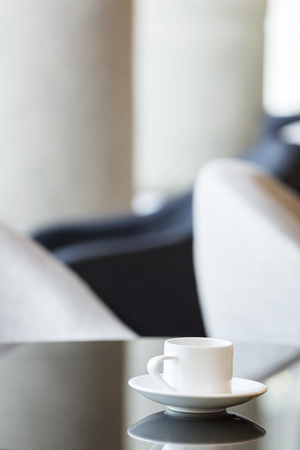 Poland,Warsaw,coffee cup at lounge of hotel