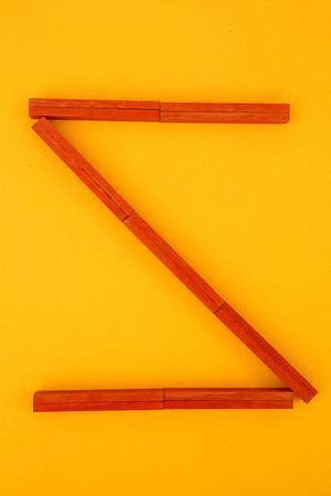 Letter Z formed of red building bricks at yellow background,studio shot LANG_EVOIMAGES