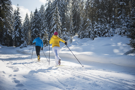 Austria,Salzburg Country,Altenmarkt-Zauchensee,Young couple cross-country skiing