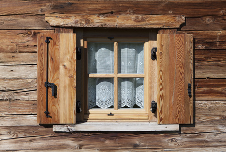 Italy,South Tyrol,Seiseralm,Window with curtain of alpine cabin