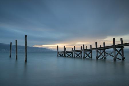 Germany,Baden-Wuerttemberg,Reichenau Island,wooden boardwalk at twilight