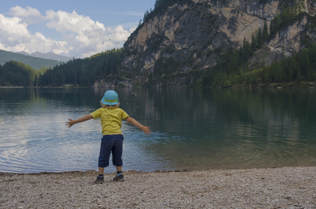 Italy,Trentino-Alto Adige,Alto Adige,Puster Valley,little boy standing at lakeshore of Lake Prags