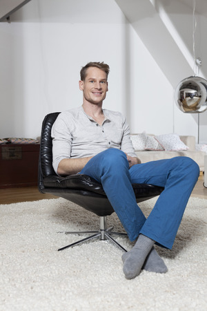 Man at home relaxing in armchair
