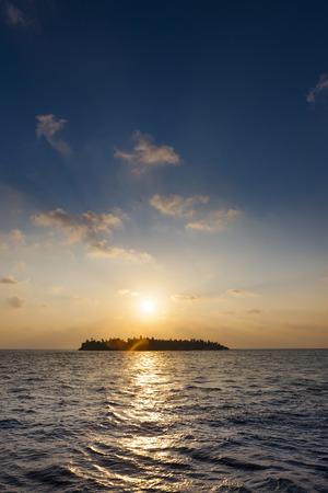 Maldives,Island at sunset LANG_EVOIMAGES
