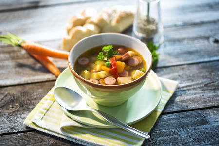Vegetable soup with sausage in bowl LANG_EVOIMAGES