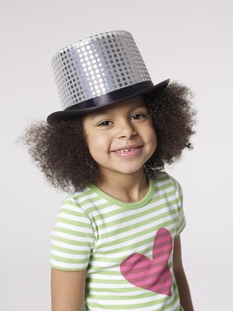Smiling girl wearing top hat