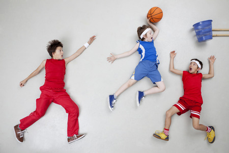 Boys playing basket ball LANG_EVOIMAGES