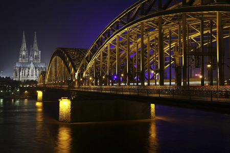 Germany,North Rhine-Westphalia,Cologne,lighted Cologne Cathedral and Hohenzollern Bridge at night